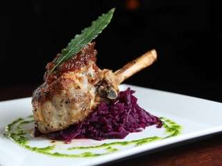 Pan-seared pork chop is paired with braised cabbage