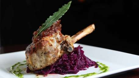 A pan-seared pork chop is paired with braised