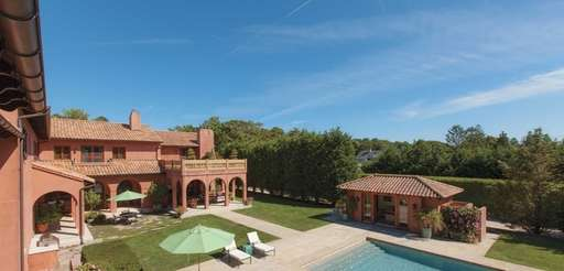 This Tuscan-style villa in Quiogue is on the