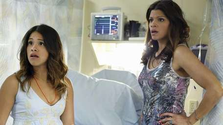 Gina Rodriguez, left, as Jane and Andrea Navedo