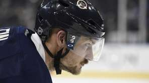 New York Rangers defenseman Kevin Klein looks on