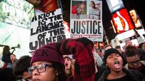 People protest in Times Square over the Ferguson