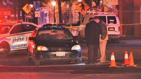 Investigators at the scene where a man was