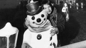 James Devlin, then 8, hugs Frosty the Snowman