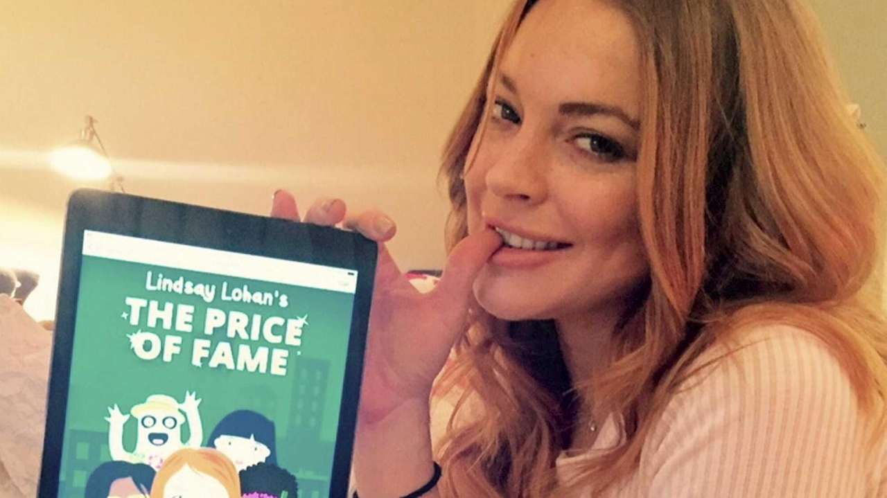 Lindsay Lohan shows off her new gaming app,