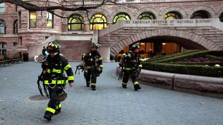 Firefighters leave the American Museum of Natural History