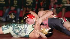 Sachem East's Fernando Costa takes gets ready to