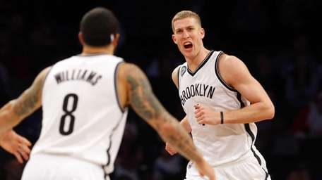 Mason Plumlee of the Brooklyn Nets reacts after