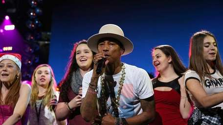 Pharrell Williams performs onstage during iHeartRadio Jingle Ball