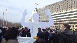 An effigy implicitly conveys the slogan