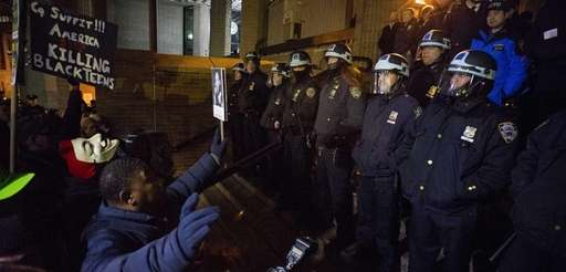 Protesters who marched earlier face off with NYPD