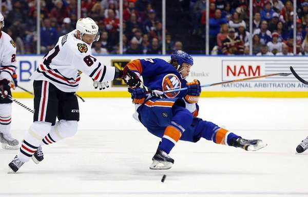 Marian Hossa of the Chicago Blackhawks knocks Matt
