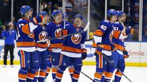 Lubomir Visnovsky of the New York Islanders salutes