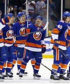 Lubomir Visnovsky of the New York Islanders salutes