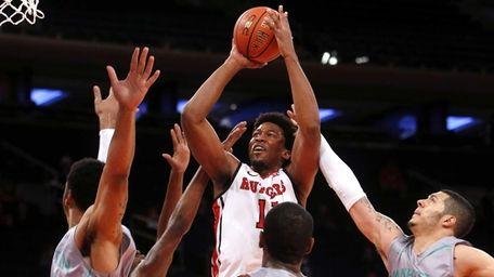 Rutgers' Kadeem Jack (11) shoots against Manhattan during