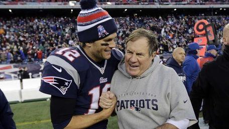 New England Patriots quarterback Tom Brady, left, celebrates