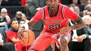 St. John's Rysheed Jordan (23) dribbles the ball
