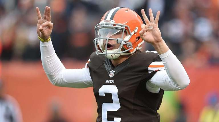 Johnny Manziel of the Cleveland Browns signals during