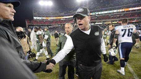 New York Jets head coach Rex Ryan, center,