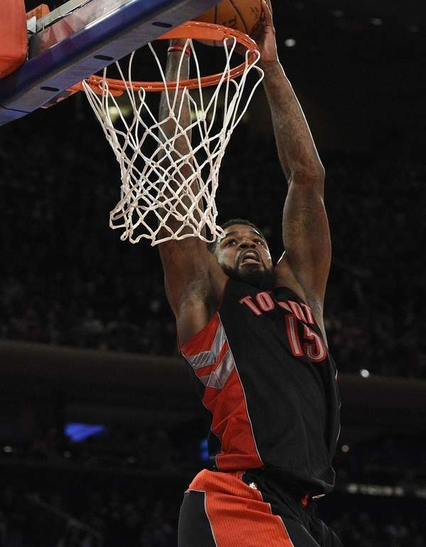 Toronto Raptors forward Amir Johnson dunks the ball