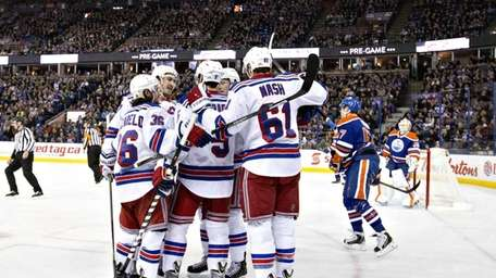 The New York Rangers celebrate a goal as
