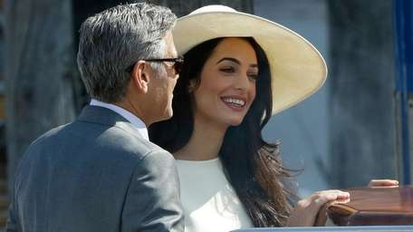 George Clooney and Amal Alamuddin leave Venice's city