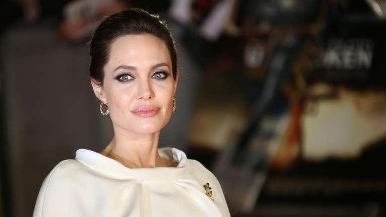 Actress Angelina Jolie poses for photographers upon arrival