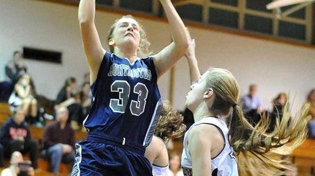 Huntington's Samantha Lynch drives to the basket during