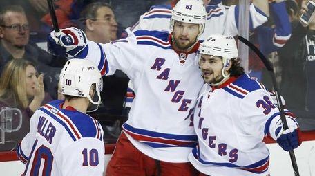 The New York Rangers' Rick Nash, center, celebrates