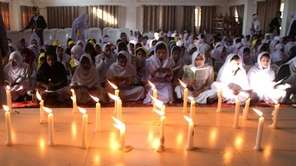 Pakistani schoolchildren pray for victims who were killed