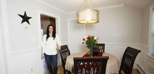 Trisha Creata, 34, shows the dining room of