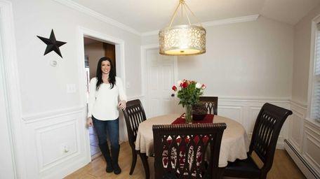 Trisha Creata, 34, shows the dining room of