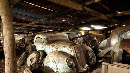 A collection of dusty and rusty vehicles found
