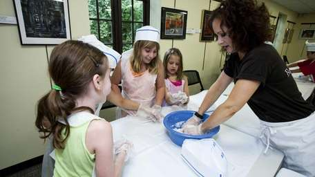 Lynn Martinek from The Baking Coach teaches children