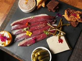 The duck platter includes a slab of slate