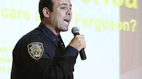 NYPD Officer John Sheik speaks to Uniondale High