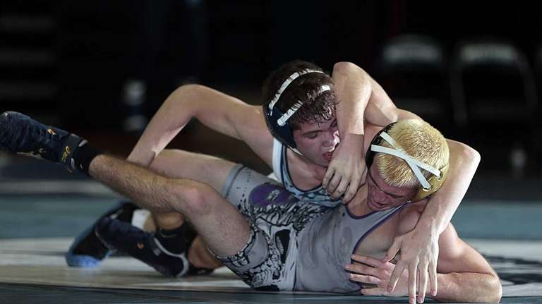 Rocky Point's Nick Pagnotta controls Islip's Mike Alesi