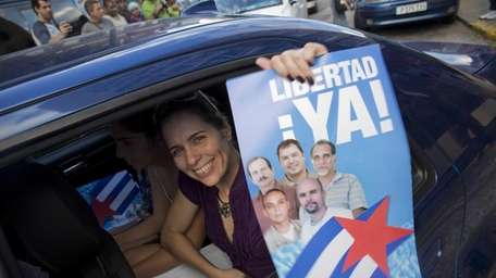 A woman with a poster of the Cuban