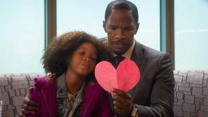 Quvenzhane Wallis as Annie, and Jamie Foxx as