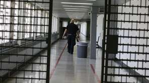 A Rikers Island juvenile detention facility officer walks