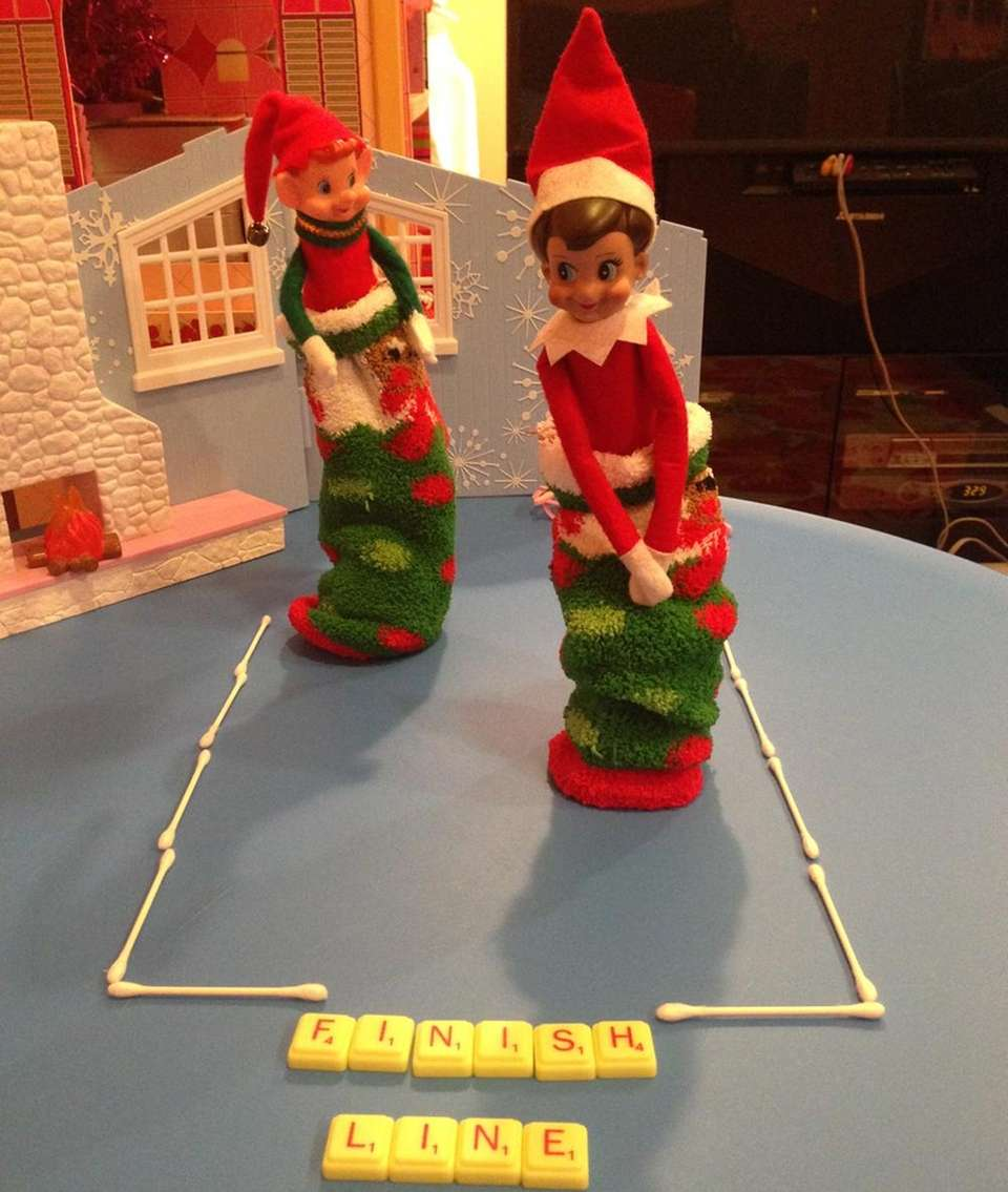 Our Elf Cookie, sack/sock racing with her friend.