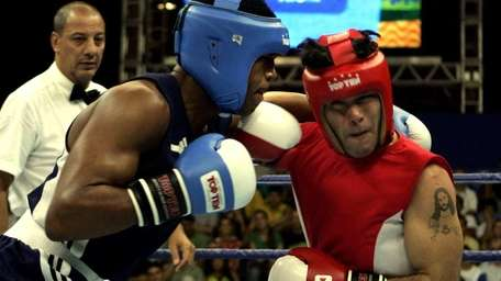 Argentina's Diego Chaves, right, fights against Bahamas' Tureano