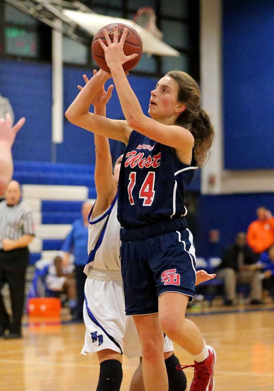Smithtown West guard Brenna Butler puts up the