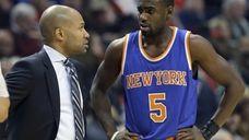 New York Knicks head coach Derek Fisher, left,