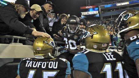 Jacksonville Jaguars running back Jordan Todman (30) celebrates