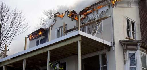 Firefighters battle a fire in an unoccupied home