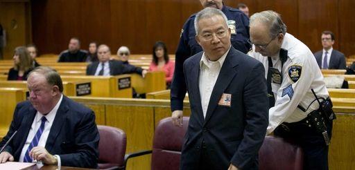 Dr. Stan Li, 60, enters a court room