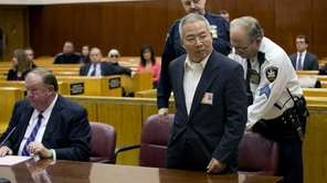 Dr. Stan Li, 60, enters a court room