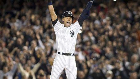 The New York Yankees' Derek Jeter jumps for