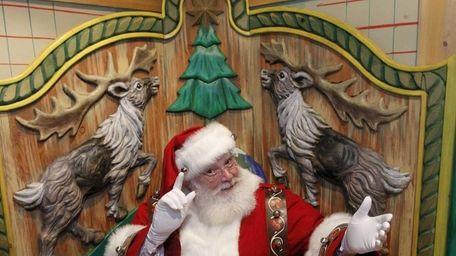 Santa at the 13,000-square-foot Christmas Village in Macy's,